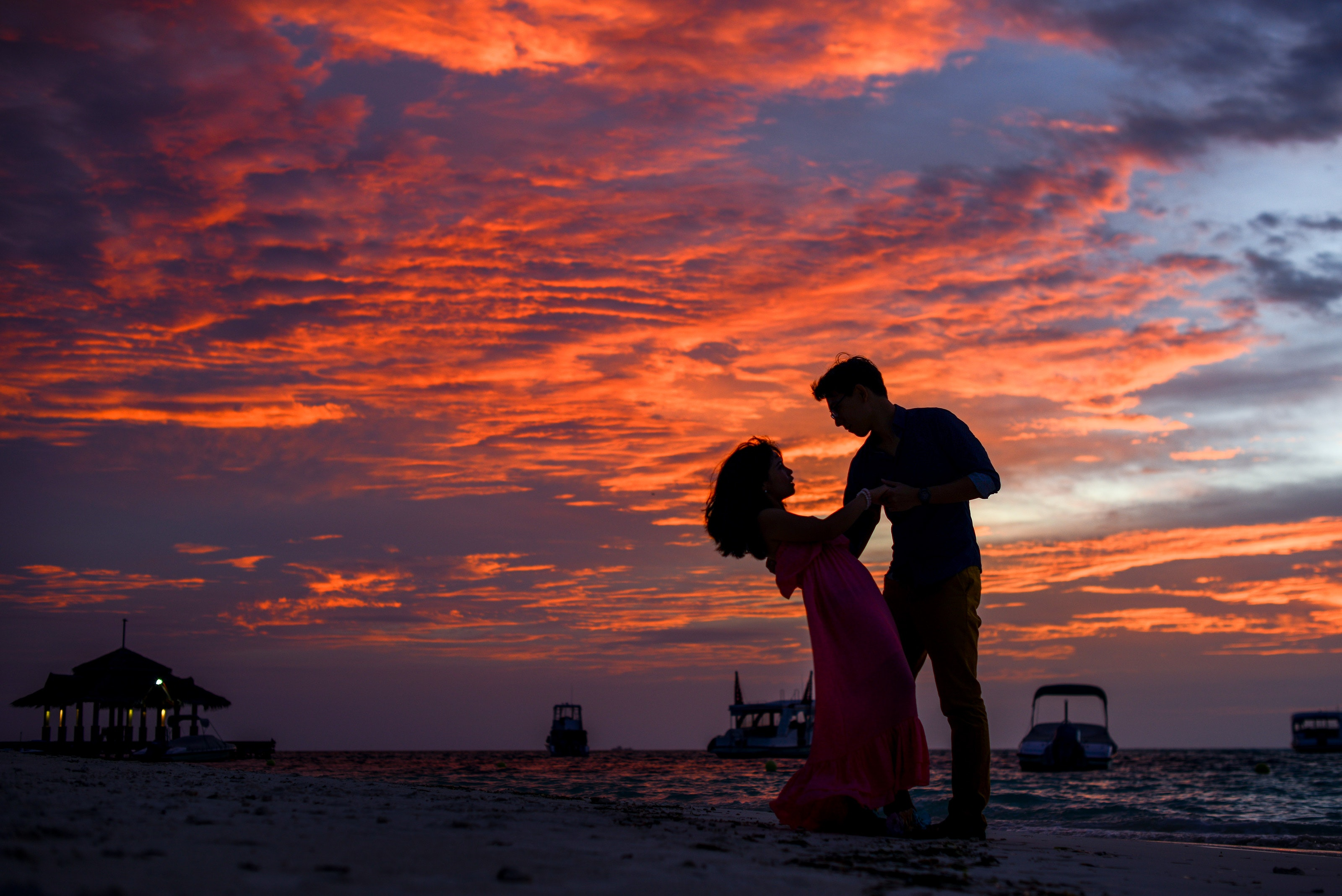 man-and-woman-on-beach-during-sunset-1024963.jpg