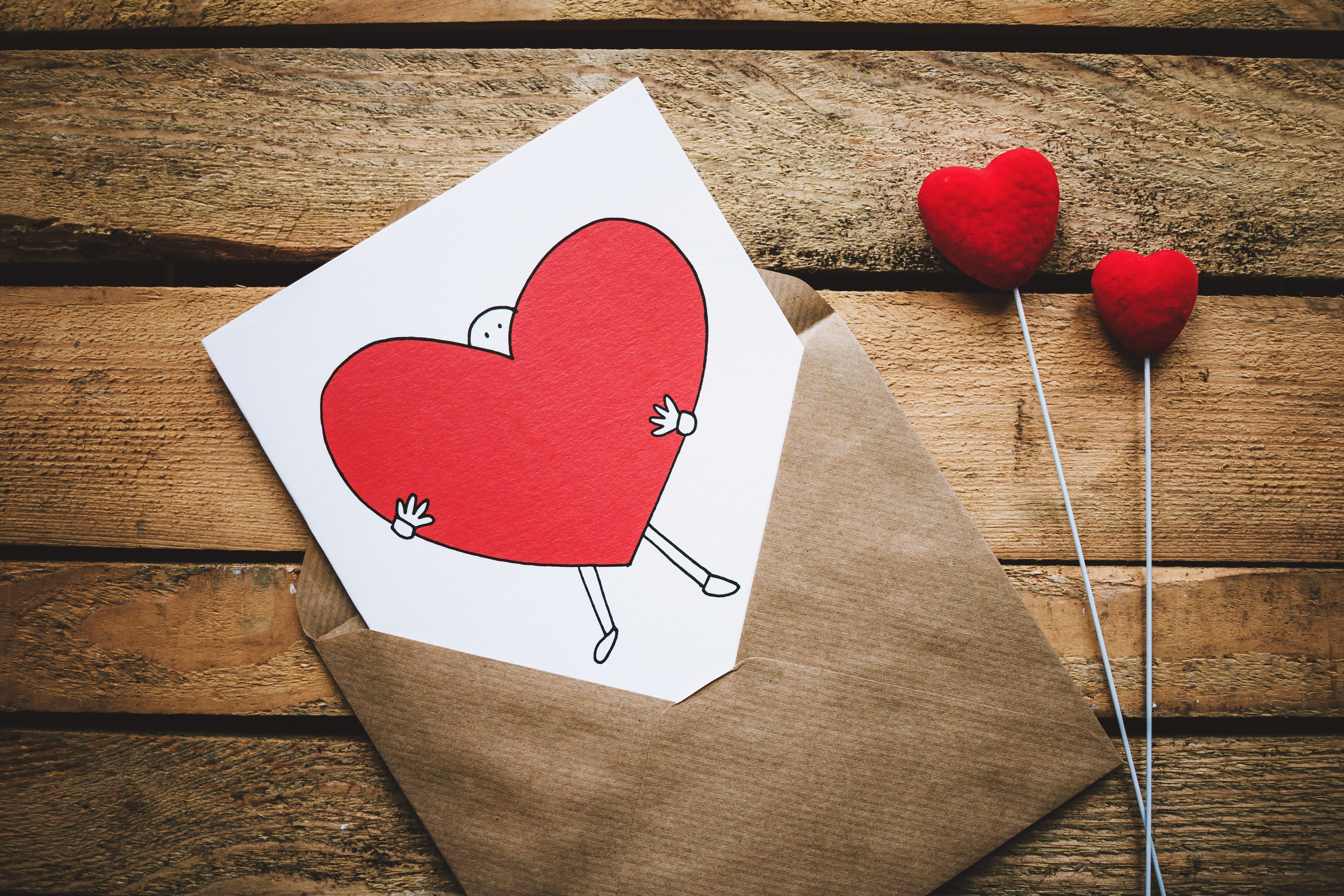 white-black-and-red-person-carrying-heart-illustration-in-867462.jpg