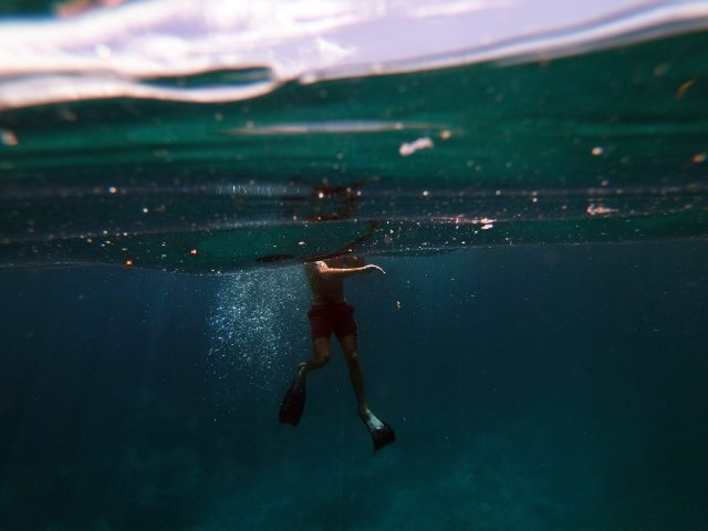 man-in-black-shorts-in-water-3544412