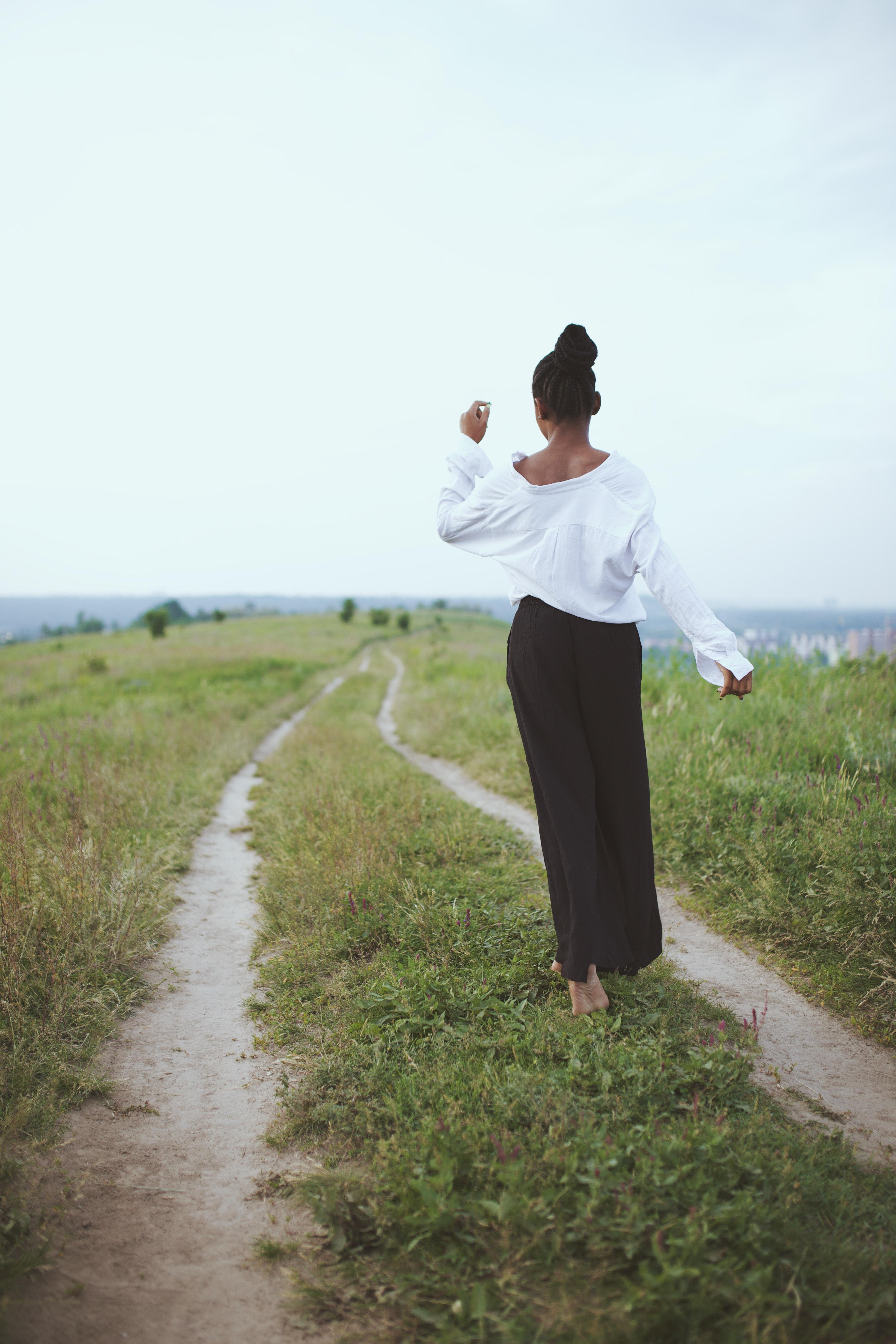 photo-of-woman-walking-on-grass-2399173.jpg