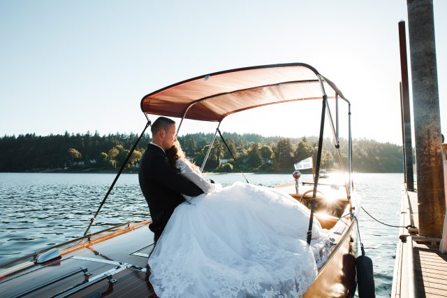 bride-and-groom-riding-powerboat-1439264