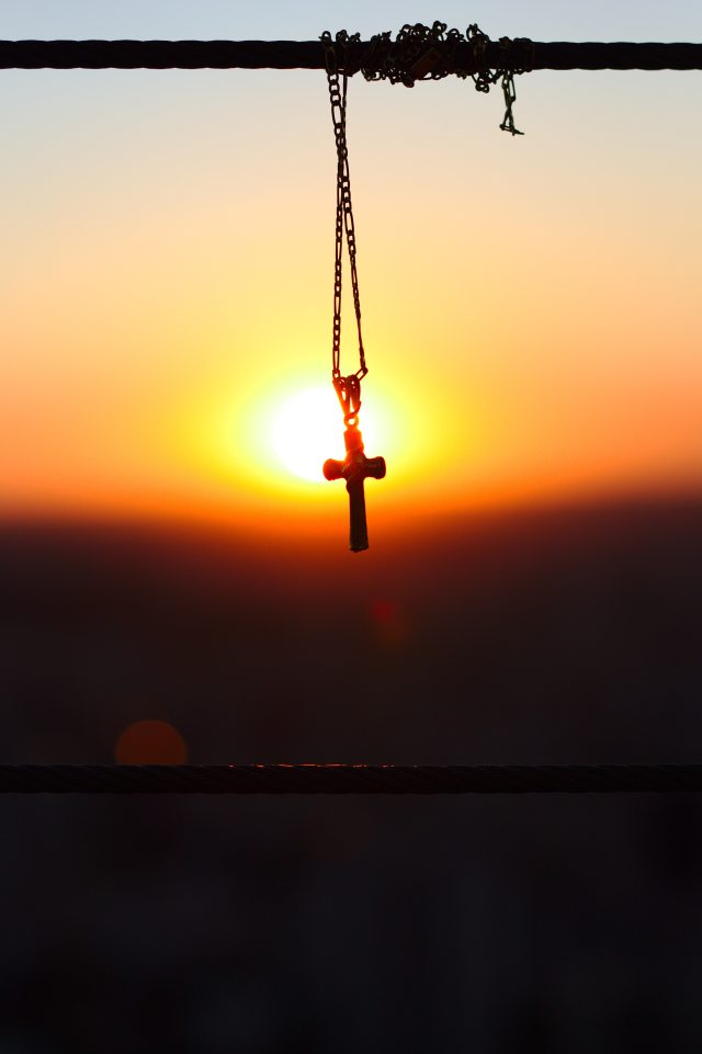silhouette-photography-of-chain-necklace-with-cross-pendant-2752462
